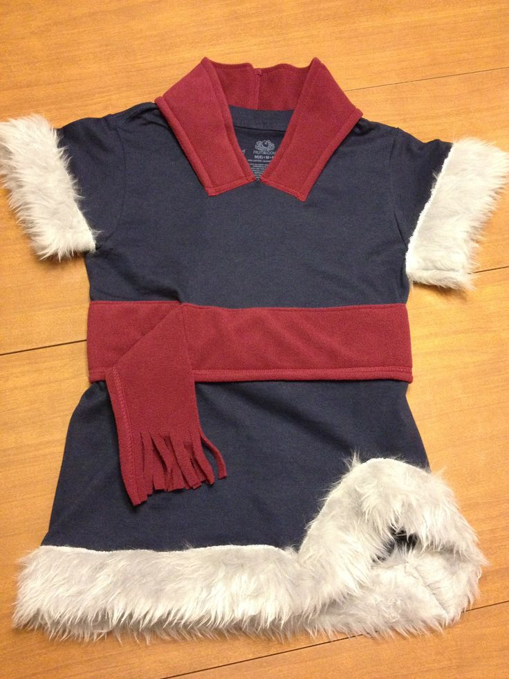 DIY Christof costume created from a boys t-shirt, woman's polar tech scarf (used for belt) and ear band (used for neck trim), and 1/4 yard fur fabric.Cut sleeves off t-shirt at angle and attach fur.Cut small v in neck of t-shirt then cut one side of ear band and attach to neckline of t-shirt.  Attach scarf as belt and make v shape cut on lower right of t-shirt and attach fur. Pairing with a long sleeve blue shirt and grey pants and we are ready for the Frozen themed birthday party