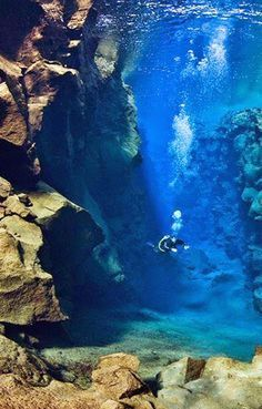 Scuba diving at the Turquoise Cave in Melissani Lake, Greece