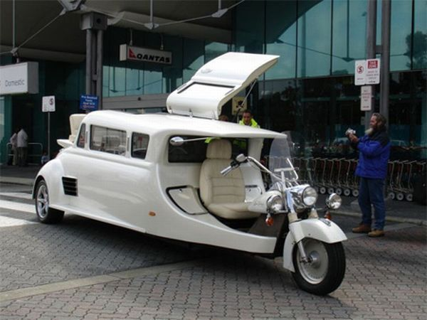 Harley Davidson Limousine. *This is awesome!! I wanna see a biker bride use this at her wedding. I can just picture a beautiful ivory gown worn with bike boots, with photos of them showing while she's riding in the back!!