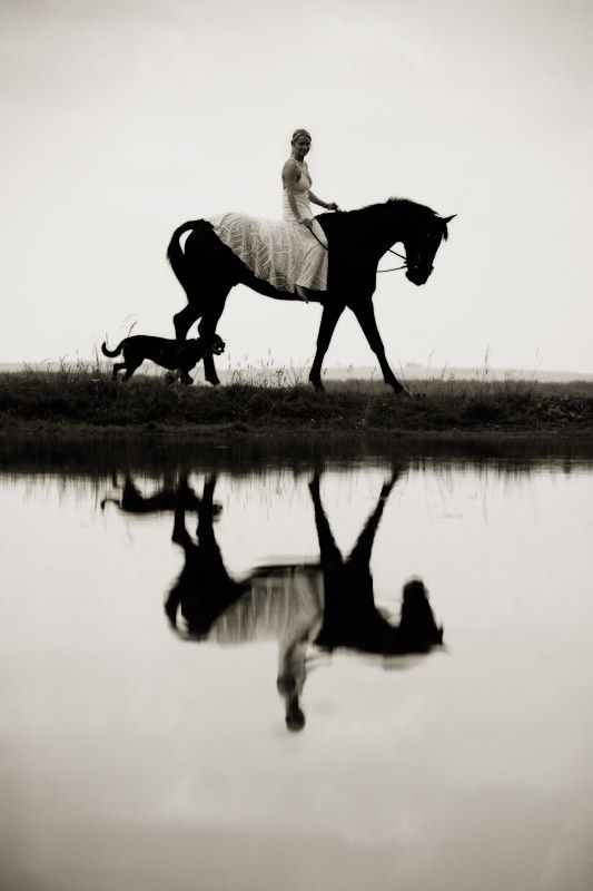 I'm going to have a picture like this in my wedding dress. My horse isn't black though but it would still be cool.
