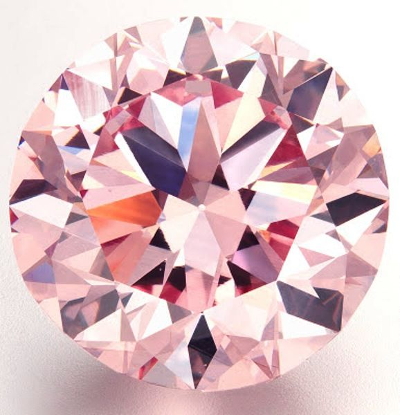 "The 12.04-carat ""Martian Pink"" diamond sold for 17.4 million dollars at auction in Hong Kong in 2012."