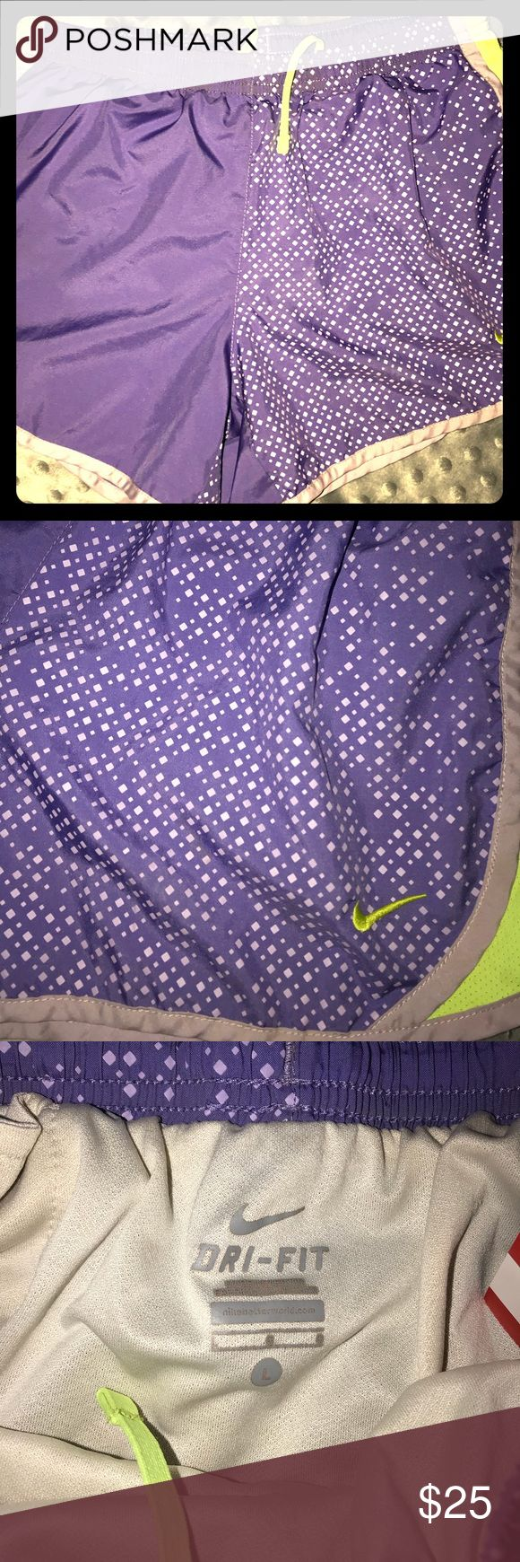 Nike Dri-Fit Purple Neon Green Shorts Large EUC  Super cute running shorts  Women's size Large  Give yourself the boost you need to beat your personal record with the Nike® Women's 3'' Dry Tempo Running Shorts. An elastic waistband secures the fit, side mesh panels ventilate, and reflective details enhance visibility in low light. The 3-inch inseam allows for a comfortable range of motion, while Nike® Dry fabric wicks sweat to keep you cool when practice heats up. Get streamlined support in…