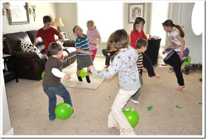 Pig Stomp. We did this at Ethan's Mario party with brown balloons (Goombas) and put coins inside. The followup game is how many bits of balloons can you pick up and whomever gets the most is the winner!