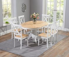 Buy the Epsom Oak and White Pedestal Extending Dining Table Set with Chairs at Oak Furniture Superstore