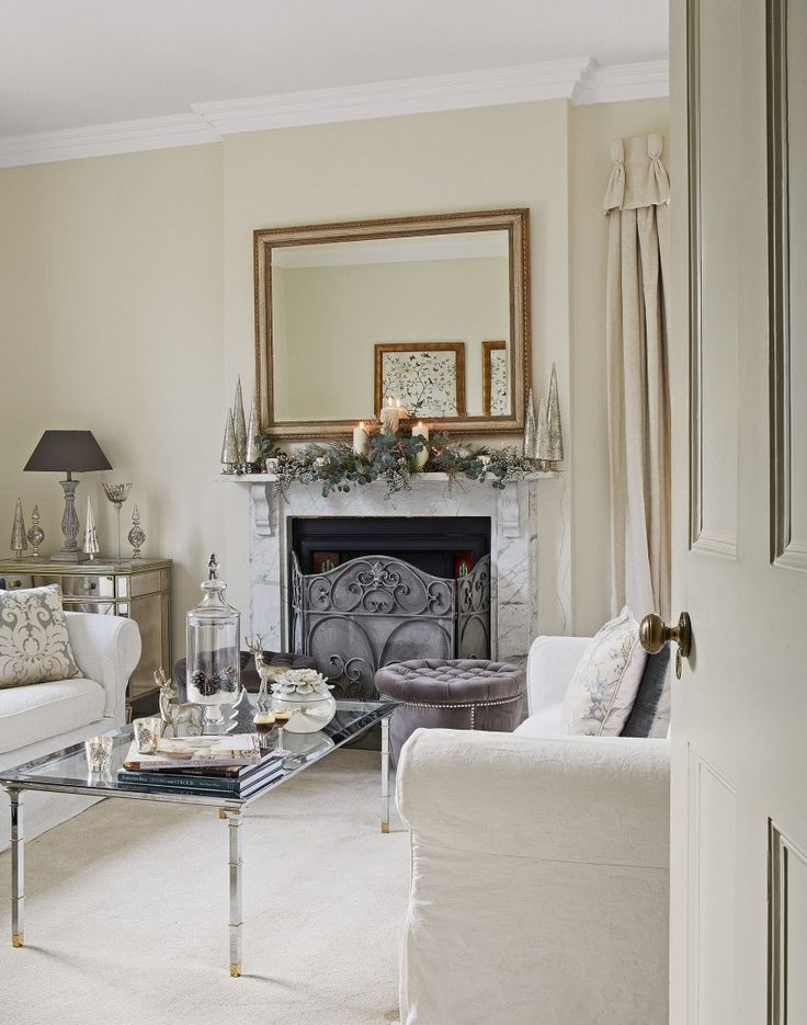 How about this for a stunning, elegant living room? A large mirror about the striking fireplace increases the light, bright feeling of the space
