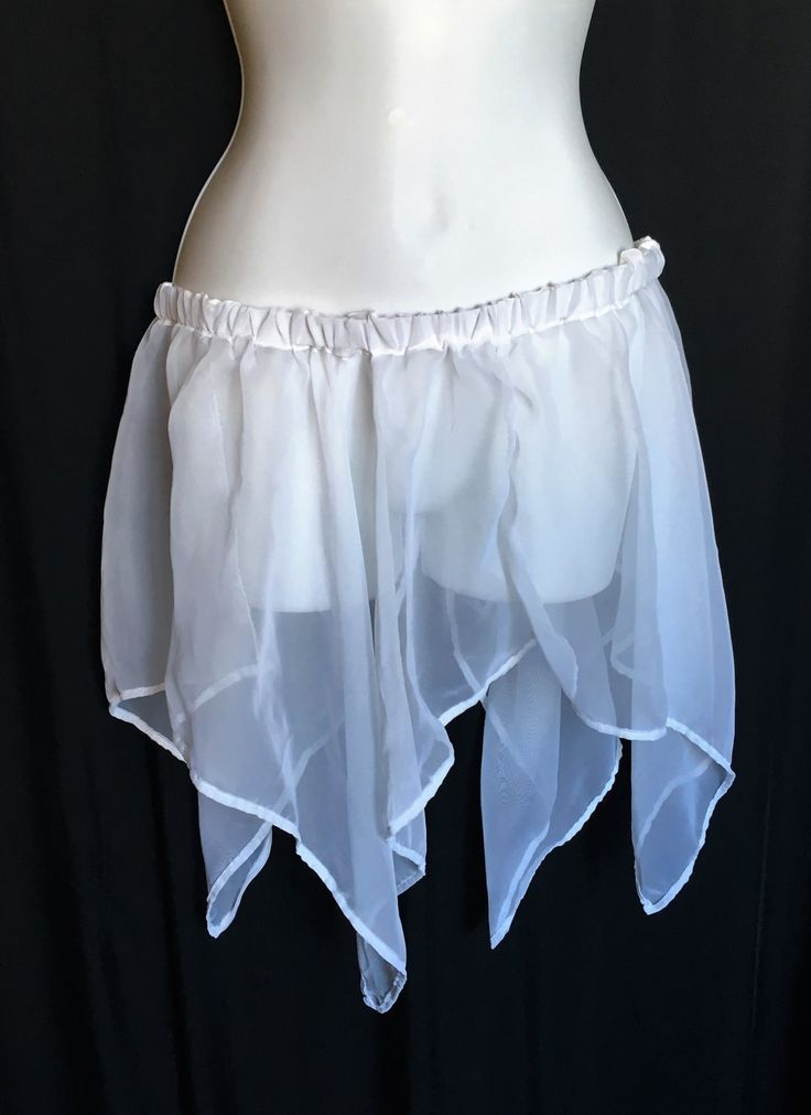 Adult White Fairy Skirt. Hip measurements: 31 - 41 Longest point is 20 long Skirt fabric is sheer and can be worn over leggings or another skirt.