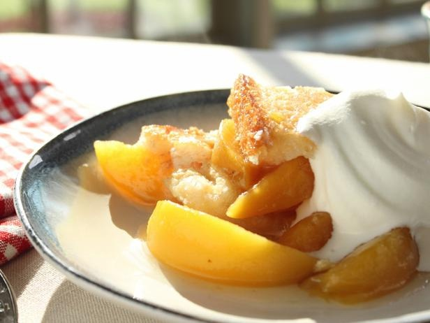 Trisha Yearwood's Easy Peach Cobbler  2 15-oz cans sliced peaches in syrup, ½ cup butter, 1 cup self-rising flour (OR 1 cup all-purpose flour + with 1½ tsp baking powder & ⅛ tsp salt), 1 cup sugar, 1 cup milk