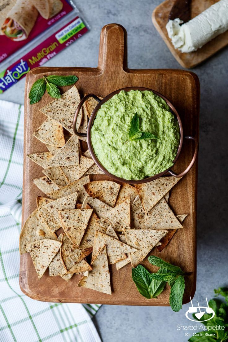 5 Minute Sweet Pea Goat Cheese Dip will be your favorite spring appetizer. A handful of ingredients, a glass of rosé, and some Flatout Flatbreads will make this will make winter seem like a distant memory.