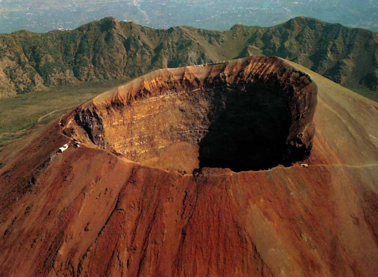 Mount Vesuvius near Naples, Italy. You can walk up the volcano and look into the crater in person! You can even keep a cooled hunk of lava from the volcano if you want.