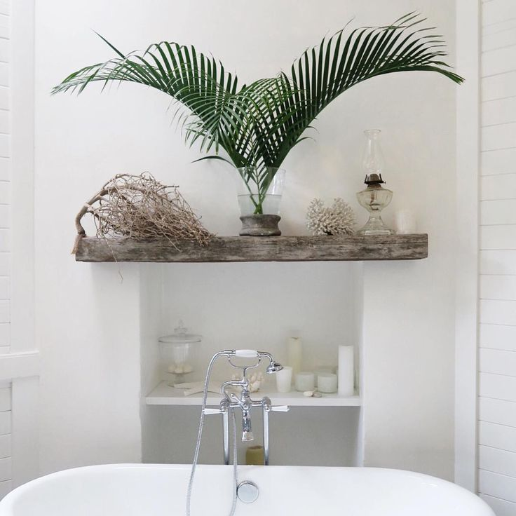 B A T H This bathroom of the Collaroy beach house project always makes me feel so calm and relaxed. The simple wall hung sleeper over the old fireplace in conjunction with wall panelling (untiled ), organic treasures, greenery and lots of white! Just the perfect spot for a soak in the claw foot tub.  Thanks for having me last night @blycarpenter can't wait to get started on the masterbedroom and hallway!! #fridaynightdesigning #champagne #pizza #alannasmitstructuralinteriors #interiord...