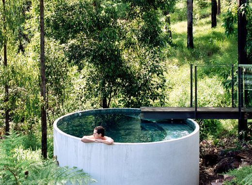 the 'plunge pool' utilizes the same prefabricated vessel used for the rainwater containment system. Brilliant! Not only is it a beautiful pool solution, in this case the benefits of these tanks go much deeper. The precast concrete rainwater tanks provide thermal massing, with the walls of the tanks being incorporated into the studio, ensuite and cellar spaces of the lower floor of the home