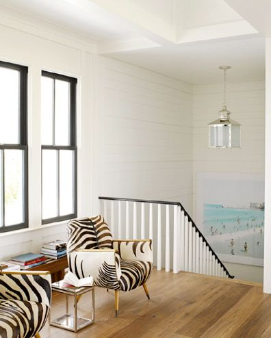 I like: 1) Stair rail is awesome, 2) Zebra Chairs are ridic, and 3) contrasting trim on the windows.  Love this whole look!