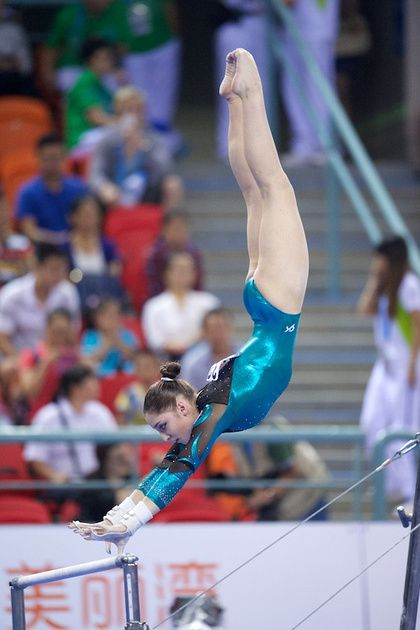 Aliya Mustafina (Russia) on uneven bars at the 2014 World Championships