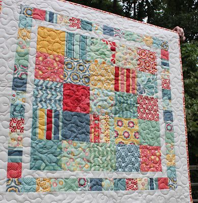 A cute table topper or baby quilt made from one charm pack, and a little yardage....good idea for a fast gift!