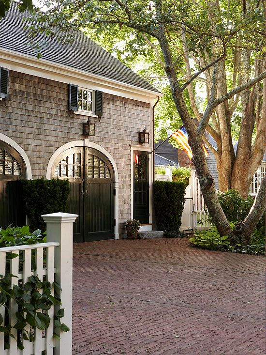 Ban boring garage doors by choosing a style with windows, molding details, or great hardware. Take a look at some of our favorites, and find inspiration to enhance your home's exterior!
