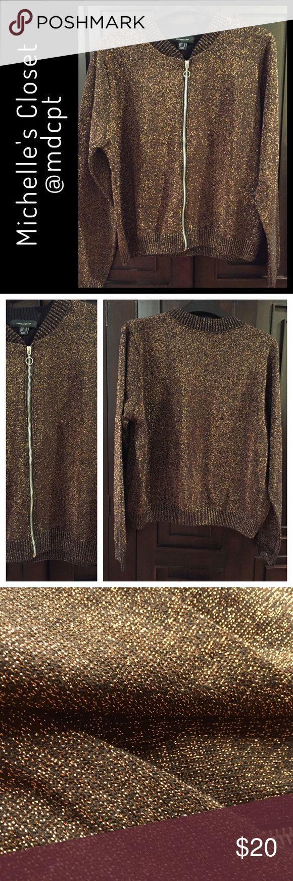 """Festive jacket Metallic fibers in a coppery tone over black background.  The pictures don't give the sparkle effect justice.  Length on back is 22"""", sleeves 24"""" long.  Bomber jacket styling with ribbed bottom, neckline and wrist cuffs.  Perfect for layering and adding sparkle to a black outfit. Jackets & Coats"""
