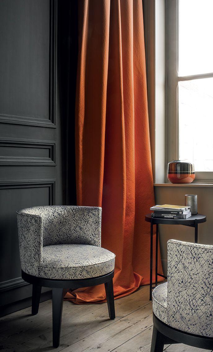 Tissu Casamance 2015. Orange in living room.