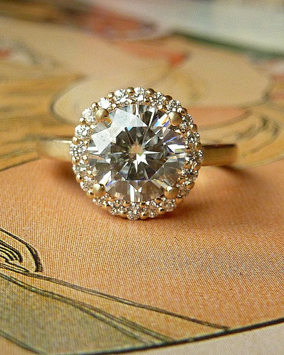 beautiful engagement ring http://www.etsy.com/listing/82736762/round-moissanite-and-diamond-halo-ring