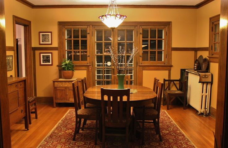 craftsman dining room with area rug hardwood floors chair rail bowl