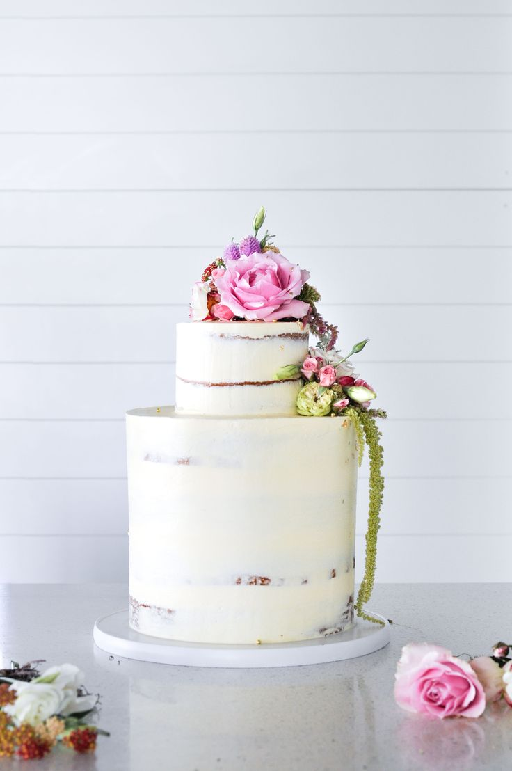 Floral and semi-naked wedding cake by LionHeart