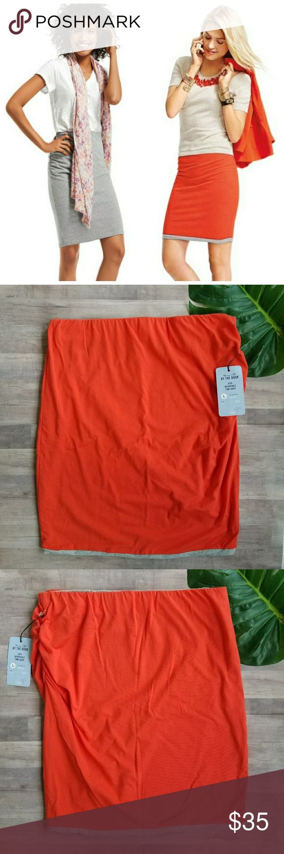 """CAbi #229 Reversible Tube Skirt Pencil CAbi.  Women's Large.  #229 Reversible Tube Skirt.  Pencil style skirt. An easy tube skirt perfect for lazy weekend days or summertime travel. One side is heathered grey, the other is our bright grenadine orange. Side ruching for great scrunch appeal. Elastic waist. 95% Cotton. 5% Spandex. Very stretchy. New with tags. Can also be worn as a strapless top. Waist- 17"""" Length- 23"""" CAbi Skirts"""