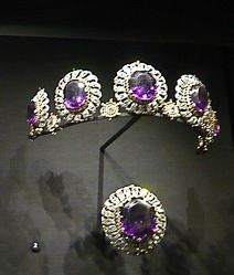 The story of Siberian Amethysts of Londonderry starts from amorous grandson of Catherine II, Alexander I, who became hopeless smitten with Lady Frances Anne Vane, Marchioness of Londonberry,upon seeing her portrait.In order to catch her eye, the Tsar lavished 14 identical and perfect Siberian Amethysts on the beautiful Frances who took the present but managed to end the love affair 'innocent of guilt'.Ca 1916 her decent turned the necklace into tiara and it is still kept by the family.