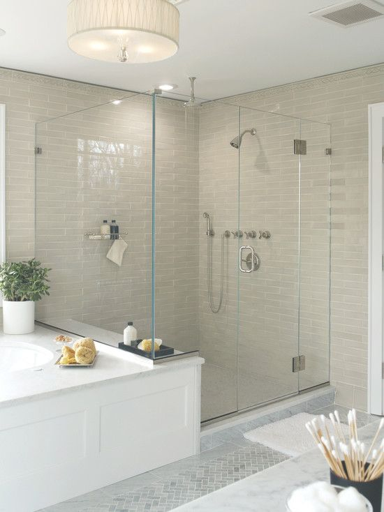 Simplicity! Love this tile and zero edge glass surround. Great idea to build around tub to look more finished.