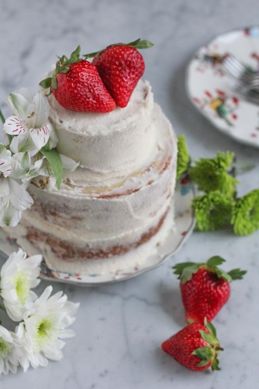 3-Tiered Strawberry cake! This cake is perfectly moist and sweet and filled with fresh strawberries!