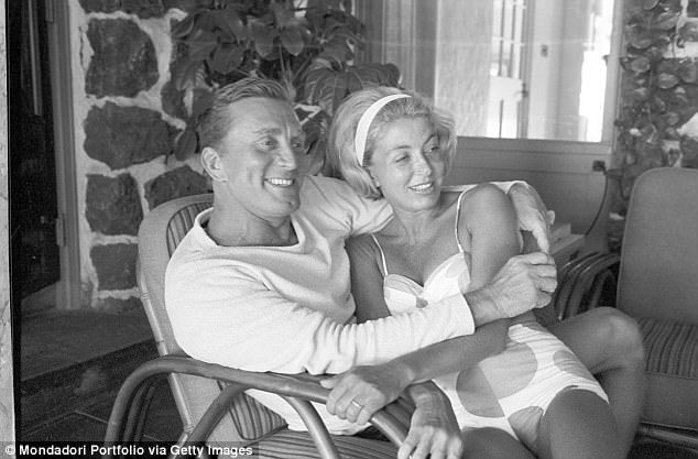 Kirk Douglas with his wife Anne Buydens at their house in Hawaii in 1965. The couple have been together for 63 years. But when they first met, Kirk was frantically in love with another woman, and Anne was married to the man who helped her to escape from the Nazis during World War II
