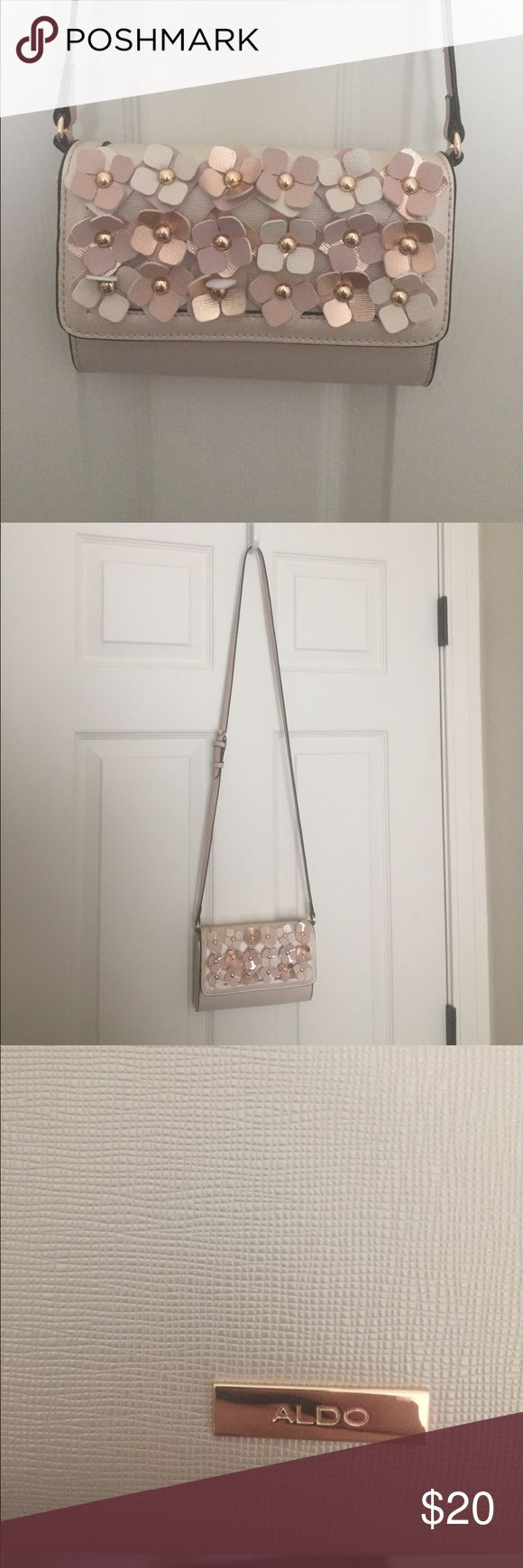 Flower Crossbody Super cute Crossbody bag with pink and beige flowers. Lots of space and strap is adjustable. Gold finishings. NWOT. Aldo Bags Crossbody Bags