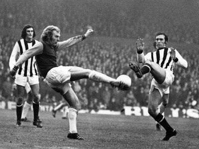 Bobby Moore clears before Jeff Astle of West Brom can get to the ball.