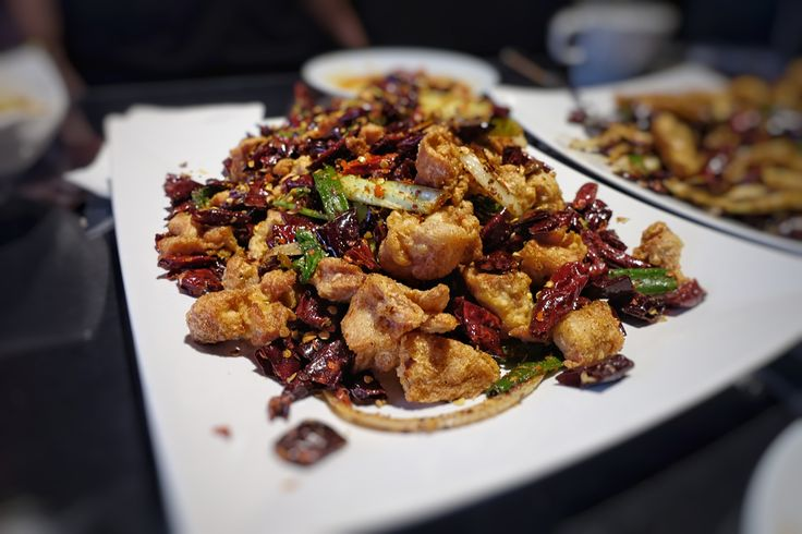 The new Chinese restaurant delivers excellent Sichuan cuisine ITP—supple wontons in chili oil, a signature chicken dish that resembles chicharrones, and a crispy blue crab worth digging your chopsticks into.