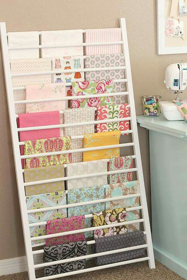 Crib side used as a fabric ladder---but I'd use it as paper storage!!