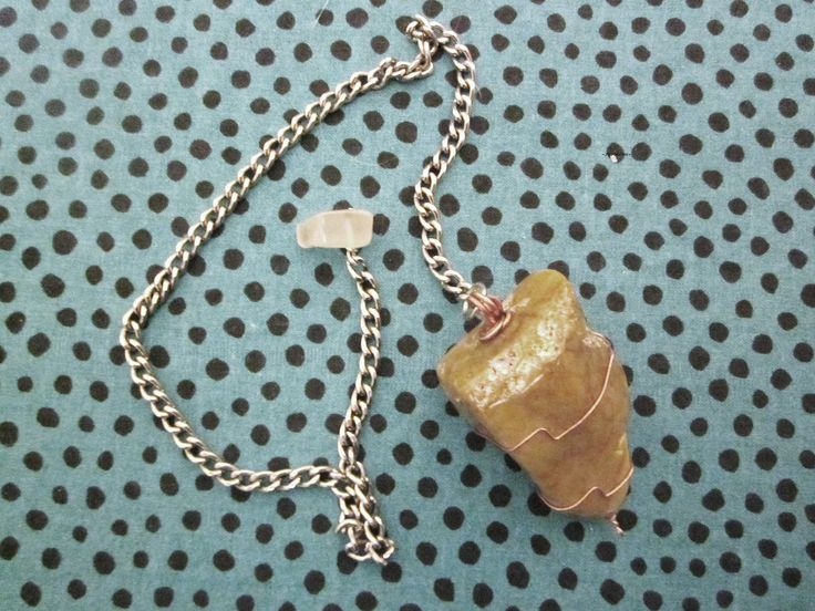 An amazing and very powerful petrified wood home pendulum to help you find the weak areas in your home and heal them or to help you find and heal also problems on your body.To the end of the chain a lovely chalcedony cleans all the energies around.Great also for working on past lives.