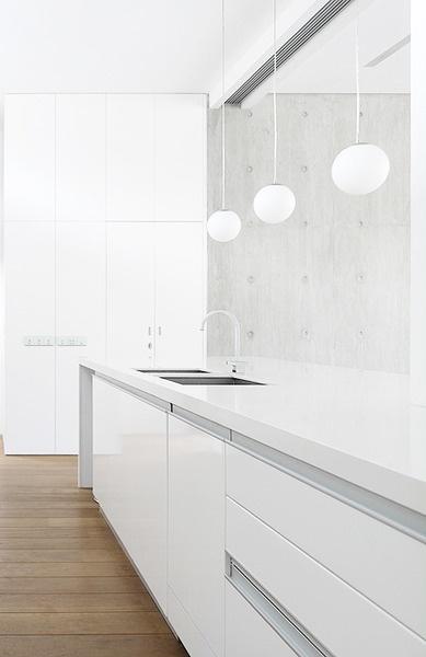 Wrap around counter minimal white kitchen sleek cabinets contemporary