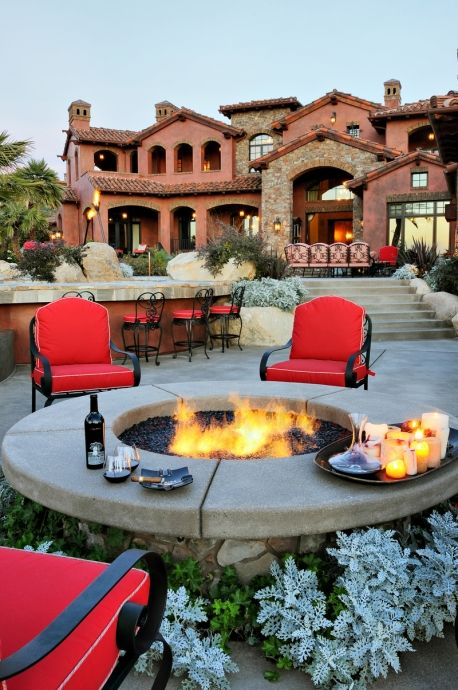 Could this be the ultimate 4th of July backyard? A duel fountain and fire pit with LED lights puts the POW into outdoor entertaining.