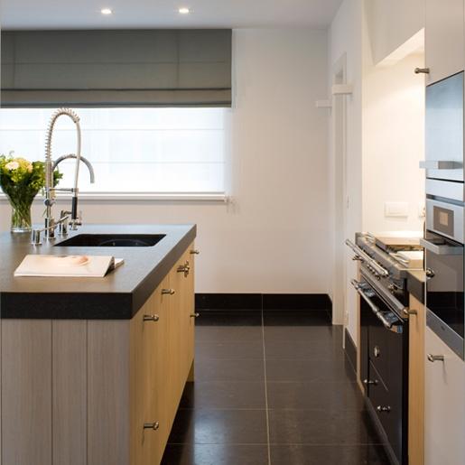 pale wood and slate contemporary kitchen b+villas - Luxury Living - exclusieve villabouw :: villas