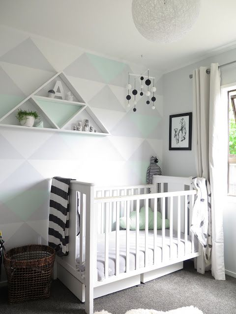 Fun, Light & Airy Baby Boy Nursery - We're in LOVE with the light gray and mint triangle accent wall.