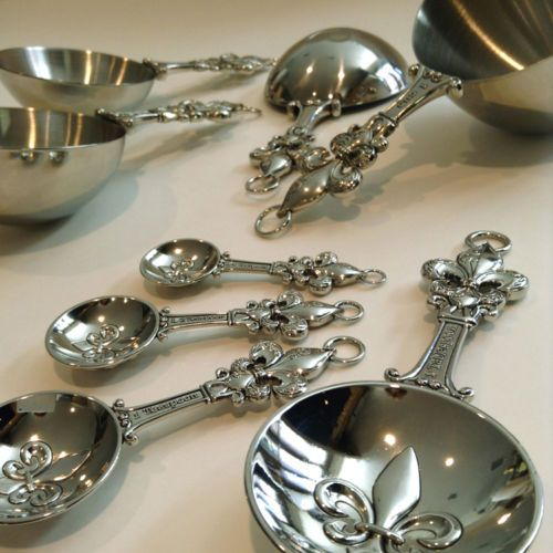 Metal Measuring Cups and Spoons Set by Ganz Fleur de Lis . Seen on eBay.