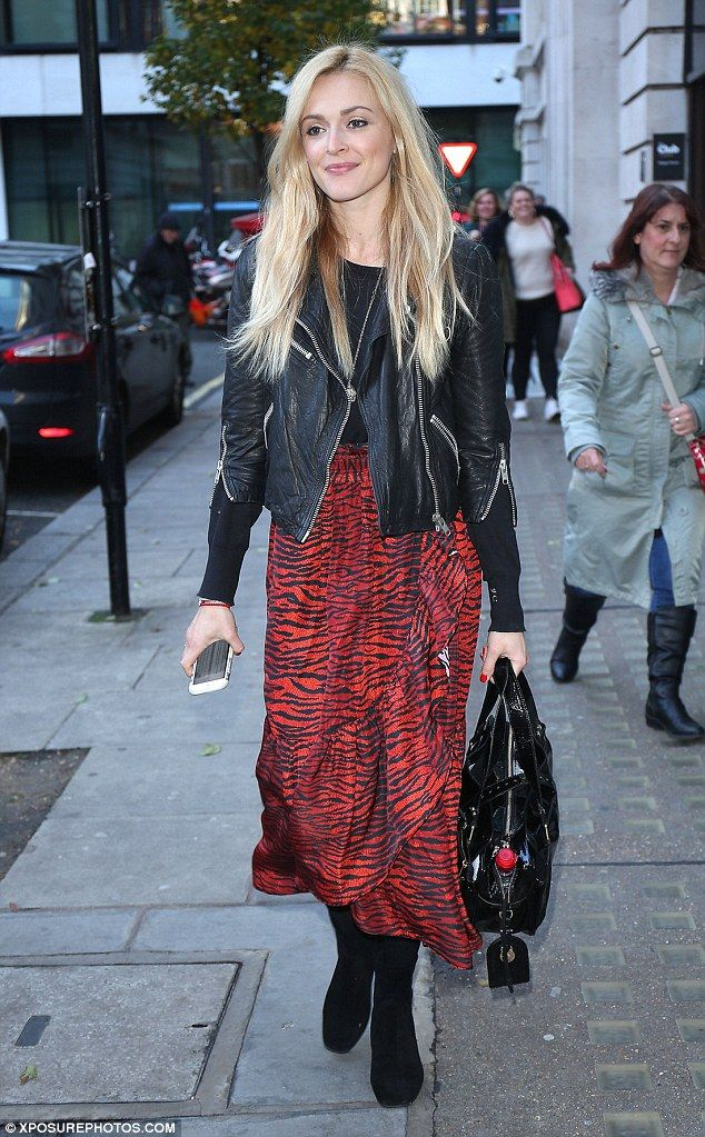 Stylish: Fearne Cotton, 35, turned heads as she showed off her svelte frame in a red animal print skirt and black leather jacket while exiting BBC Radio Studios in London on Tuesday