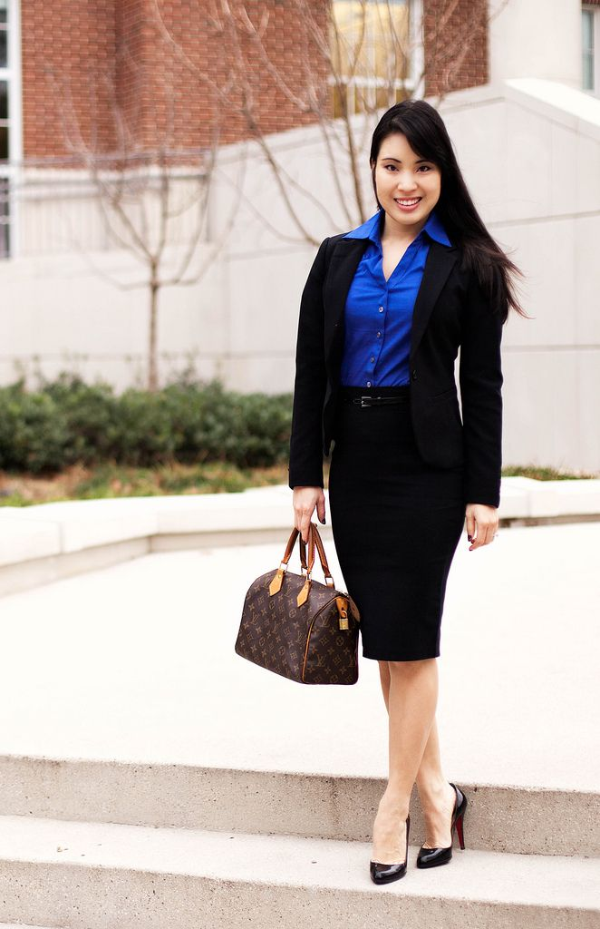 black skirt suit blue blouse and black high heels - How To Dress For An Interview Dress Code Factor