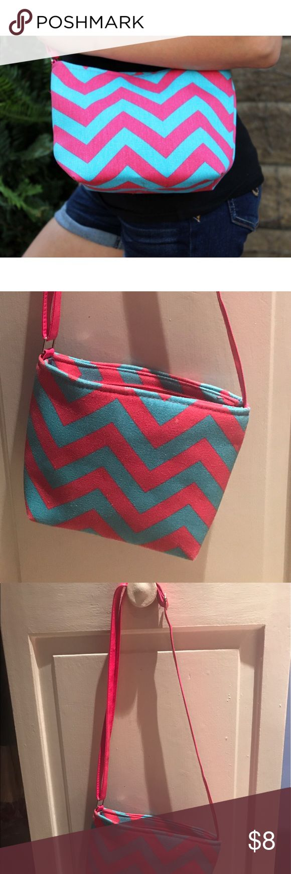 Super Cute and Trendy Chevron Purse Aqua and Hot Pink Super Cute and Trendy Chevron Purse. Like new. Only used once. This Super Cute and Trendy Chevron Purse is perfect for anyone on the go. Great for school, work, or traveling. Fun chevron/zig-zag designer fabric will take you through many seasons. Bags