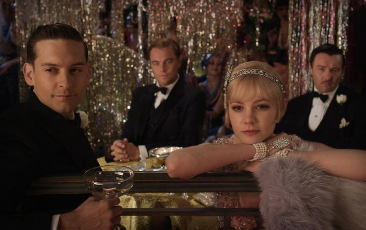 Tobey Maguire as Nick Carraway, Leonardo DiCaprio as Jay Gatsby, Carey Mulligan as Daisy Buchanan and Joel Edgerton as Tom Buchanan in Warner Bros. Pictures' and Village Roadshow Pictures' drama, 'The Great Gatsby.' A Warner Bros. Pictures release. http://numet.ro/greatgatsby  — with Tobey Maguire, Carey Mulligan Spain and Joel Edgerton.