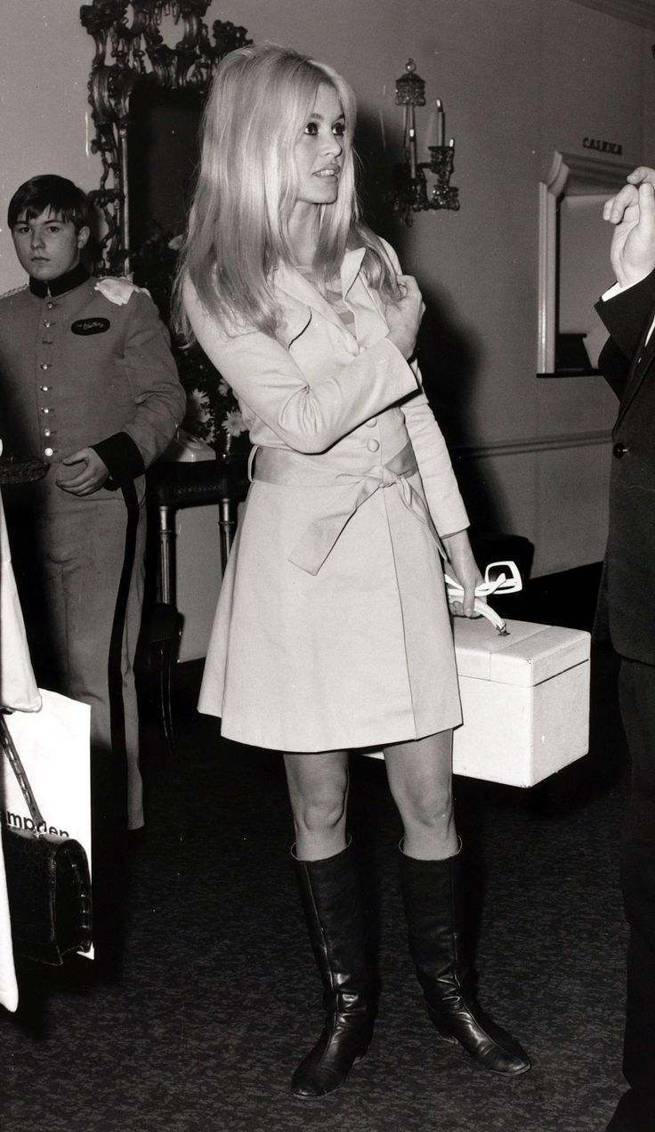 Brigitte Bardot in classic trench coat and boots. Photo: Getty Images