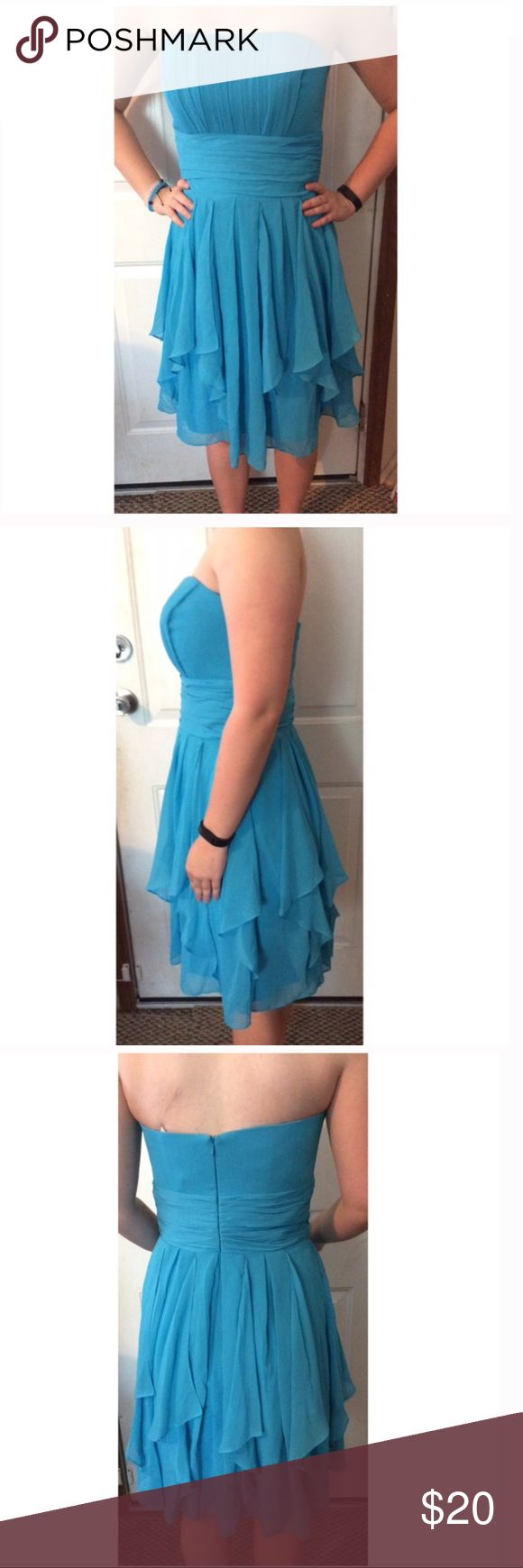 Turquoise Blue David's Bridal Strapless Dress Super cute dress, great condition. Ruffle bottom. 100% polyester. Structured top, fully lined underneath. 32.5 inches long. No trades! David's Bridal Dresses Prom