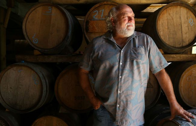Peter Bradford stands in front of a rack of barrels at his shop on Sunday August 7, 2016 in Picton, Ont. The co-owner of Canadian Vinegar Cellars is one of only a handful of practicing coopers left in Canada. Tim Miller/Belleville Intelligencer/Postmedia Network