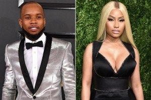Tory Lanez has plenty of stars on his new album Memories Dont Die but there was one collaboration that didnt make the final cut. According to Swavey Nicki Minaj was left off the project after some miscommunication via text.  Speaking with HotNewHipHop the Toronto rapper opened up about why Nicki was taken off Shooters at her request.  She was on Shooters originally he revealed. She was on the record first and I was telling her something about the verse I wasnt saying it was bad or anything…