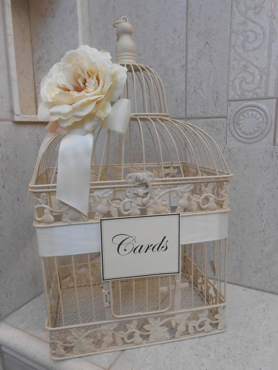 we can buy this for less and have the florist add flowers to it and make card box weddingbirdcage