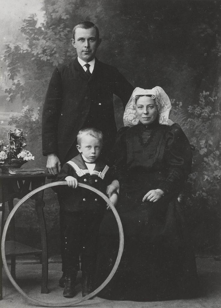 Only the woman is wearing a traditional costume. Zuid Holland. Circa 1910 Dutch family of Heerjansdam. Is the little boy in the cute sailor suit holding a small hula hoop????