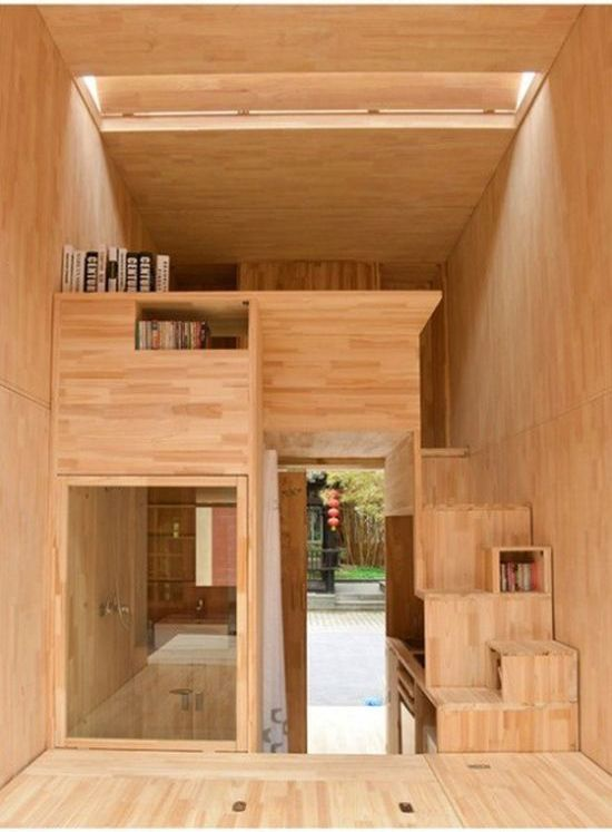 75 square foot micro house interior wood concept with steps to loft.